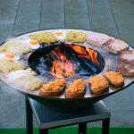 Rösti, Spiegelei und Fleischkäse auf der Feuerschale